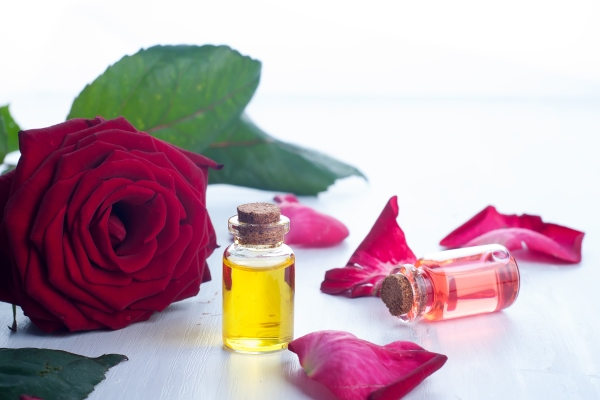 Bottles of rose essential oil and castor oil for an oil blend