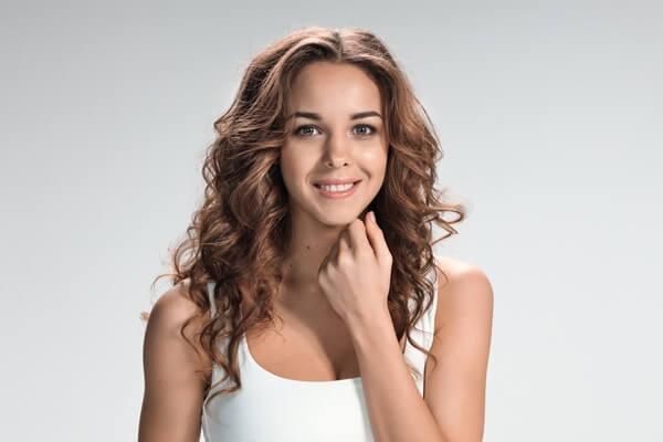 Young woman touching her beautiful face